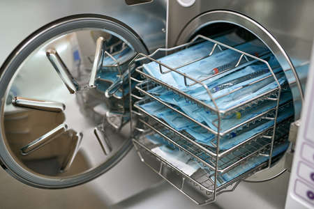 Sterilize machine with opened door and dental probes inside