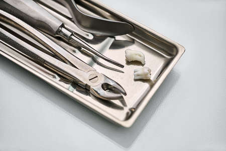 Dental instruments lying in chrome medical tray