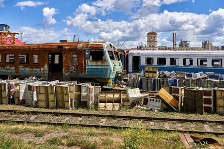 Railroad depot with abandoned trains and wagons