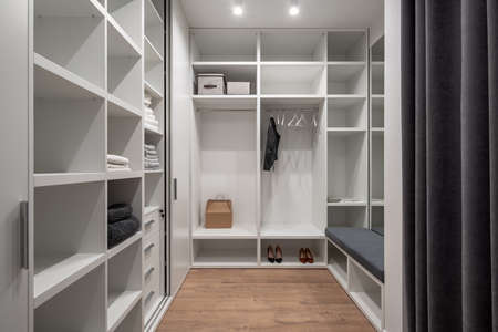 Stylish modern dressing room in light tones