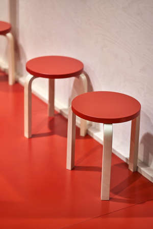 Stools with colorful seats and light legs