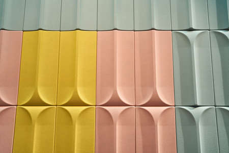 Colorful textured surface made from the rectangles with rounded ledges in the studio. They are yellow, peach and mint colored. Closeup horizontal photo. Zdjęcie Seryjne