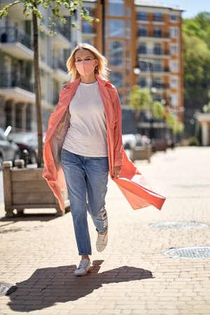 Girl walking alone outdoors during pandemic of COVID-19 Zdjęcie Seryjne