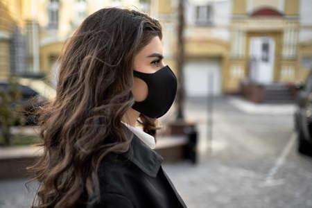 Girl posing outdoors during pandemic