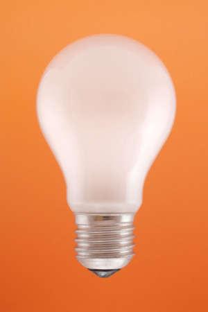 matt: White matt light bulb on orange background