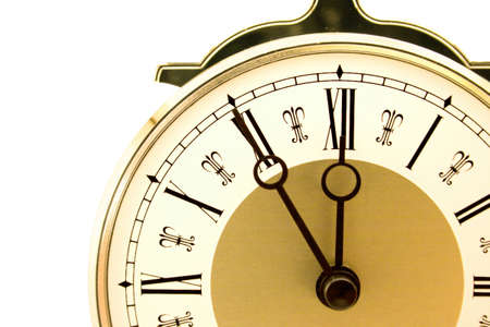 Close-up of old-fashioned pendulum clock isolated on white. Shows time 11:55 photo