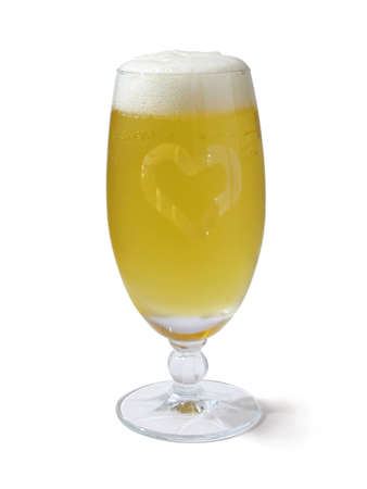 Wet glass of cold yellow beer with heart drawn by finger photo