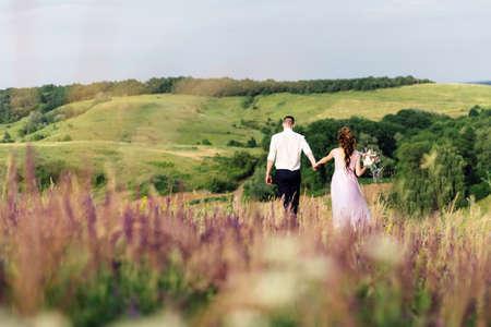 bride and groom on a wedding walk in nature 版權商用圖片