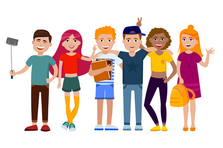Group of cute happy teenagers having fun, standing together with gadgets, backpacks and books Stock Photo