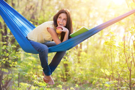 hammock: young beautiful woman in a hammock Stock Photo