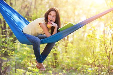 in hammock: young beautiful woman in a hammock Stock Photo
