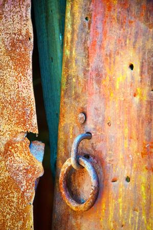 broken rusty metal door hardware