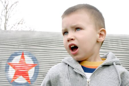 boy who tell and red star on background photo
