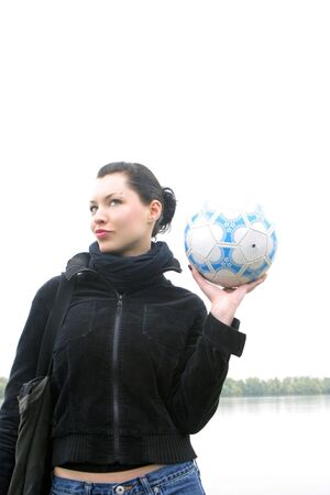 preety: girl holding in the hand ball