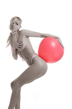blond with baloon on the ass Stock Photo