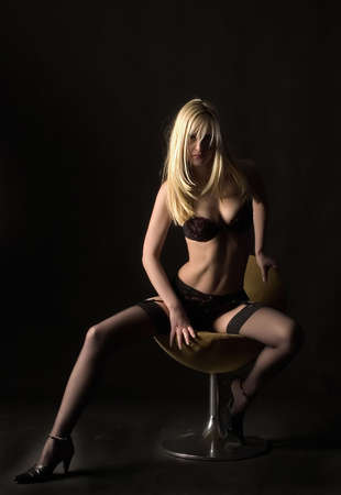 blondy is sitting on the chair Stock Photo