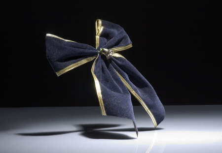 on the dole: blue knot with bell for gift Stock Photo