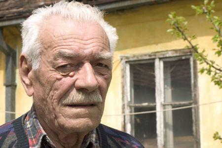 wistful: portrait of sadness old man