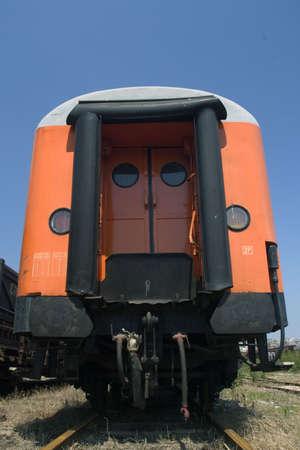 waggon: orange waggon on railway