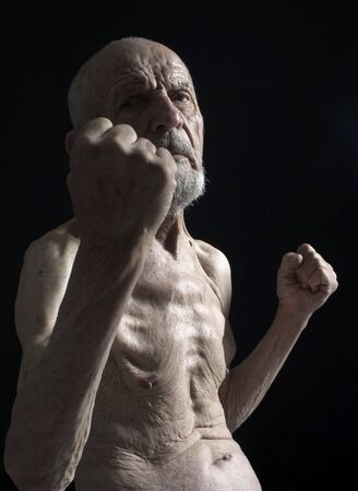 servile: old man in gard with fists