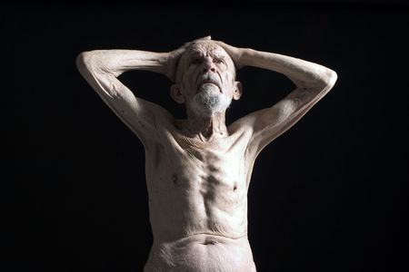 naked old man is looking up Stock Photo