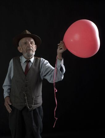 servile: senior with red balloon