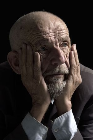 wistful: face of desperate old man