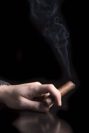 cancerous: cigar in the hand