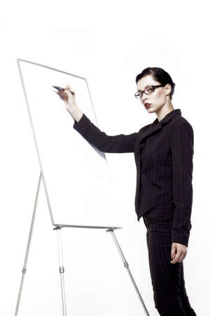 businesswoman writes on blank board Stock Photo