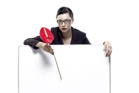 lady with glasses holds red flower and blank board Stock Photo