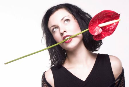 woman with red flower in her mouth Stock Photo - 470054