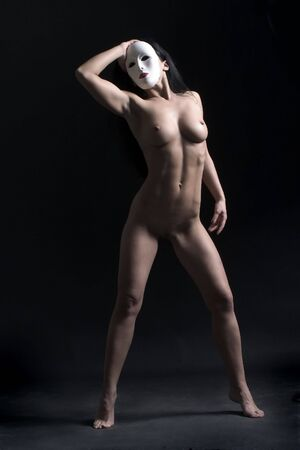 mystical nude with mask photo