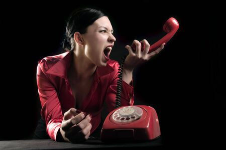 woman is yelling in the telephone Stock Photo