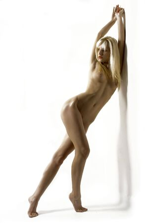 erotic fantasy: figure of blond female nude in beauty pose