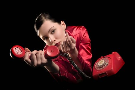 lady in red is talking  by old red phone Stock Photo - 897260