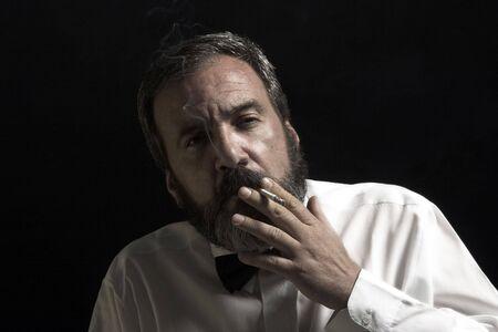 thoughtful gentleman is smoking Stock Photo - 1165353