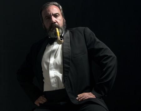 thoughtful gentleman is smoking pipe photo