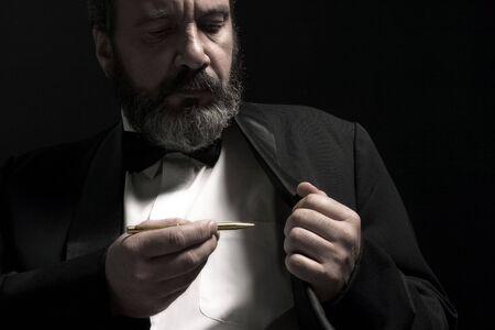 portrait of gentleman with pencil in hand photo
