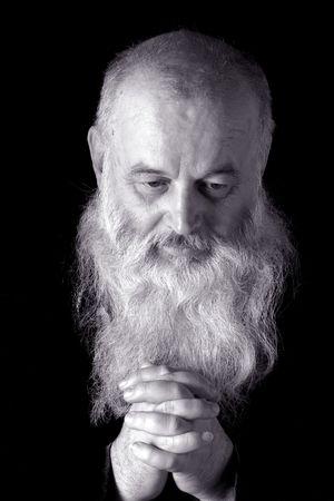 faccia disperata: servile l'uomo � in preghiera  Archivio Fotografico