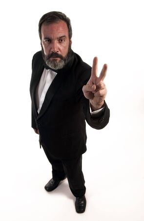 figure of angry gentleman who is standing with fingers in the peace sign