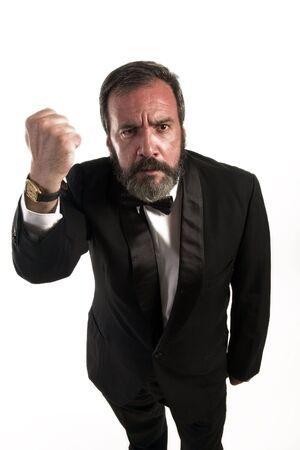 figure of angry gentleman who is standing  with fist Stock Photo
