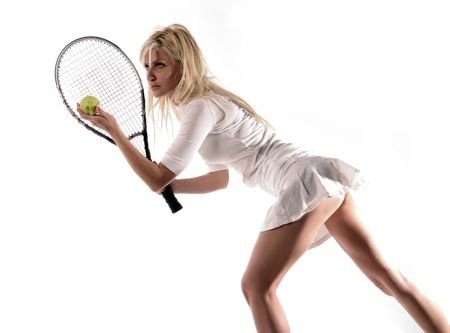 a blond girl plays tennis Stock Photo