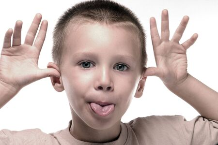 a litlle boy is making a ridicules face