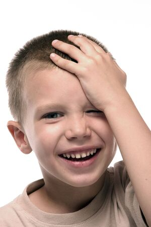 a boy remembers something funny he did Stock Photo