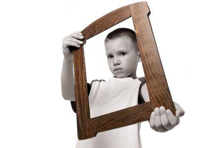 black and white boy holding frame photo