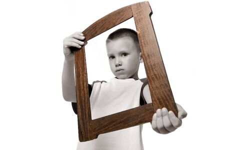 black and white boy holding frame