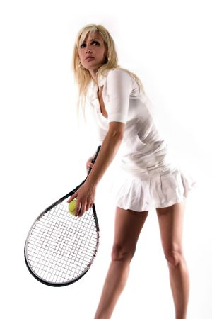 the girl is serving the ball Stock Photo