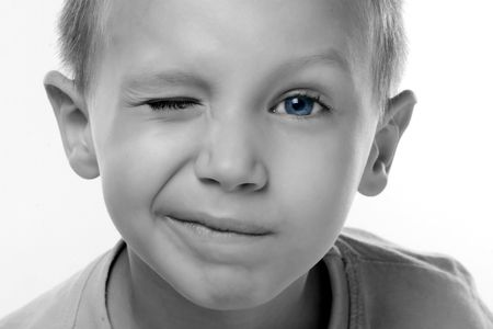a boy with blue eyes is blinking