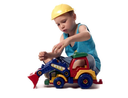 dredger: a boy is playing with his dredger