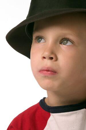 a boy is wearing a black hat photo